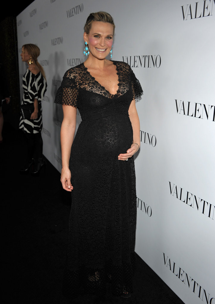 A pregnant Molly Sims attended Valentino's 50th anniversary party in LA.
