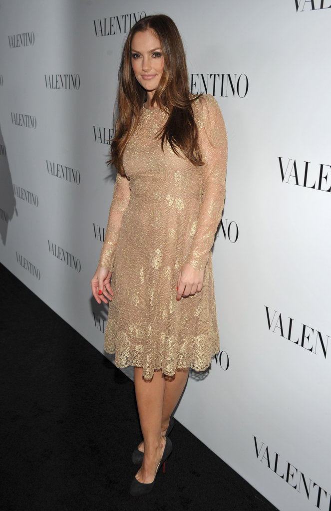 Minka Kelly wore a lace dress with gold trim to the celebrations for Valentino's 50th anniversary in LA.