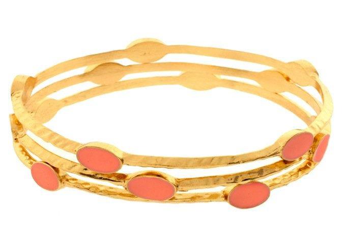 These gold bangles are cute, but have a timeless feel as well. Pieces Gaja Set of Three Bangles ($13)
