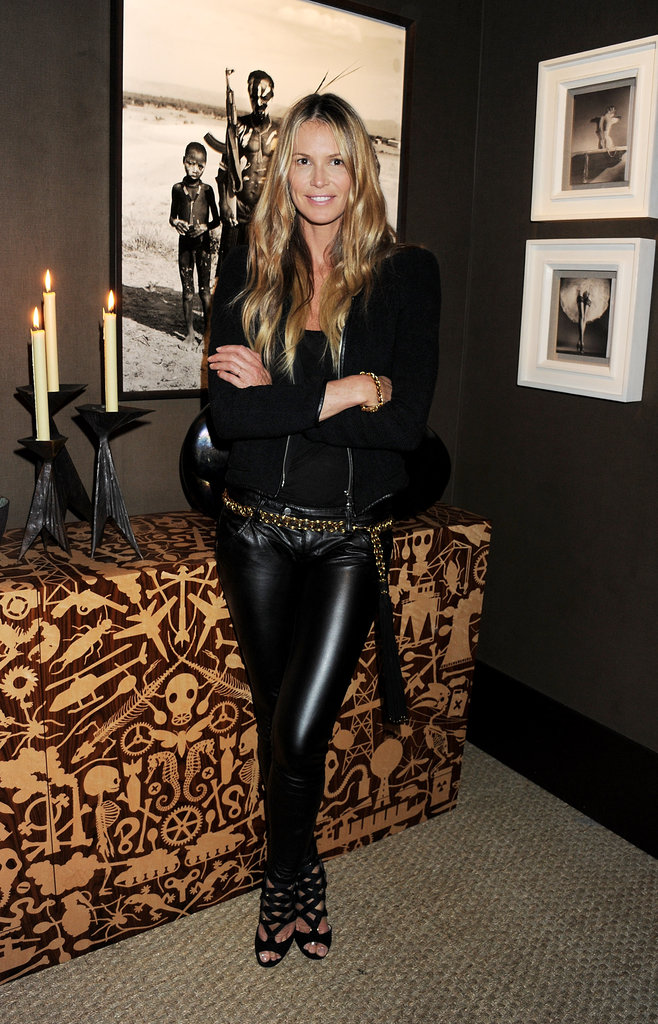 Elle loves leather, and she pulls it off every time. Here she kept her pants classic with a gypsy edge via a black zip jacket, caged sandals, and a gold chain belt around her waist.                     Leggings by PaigeSandals by Stuart Weitzman