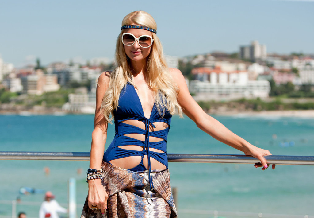 Paris Hilton wore a headband and blue bathing suit to Bondi Beach in Australia.