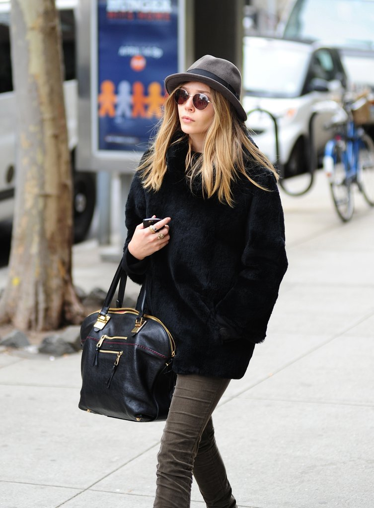 Elizabeth Olsen wore a large hat and sunglasses.