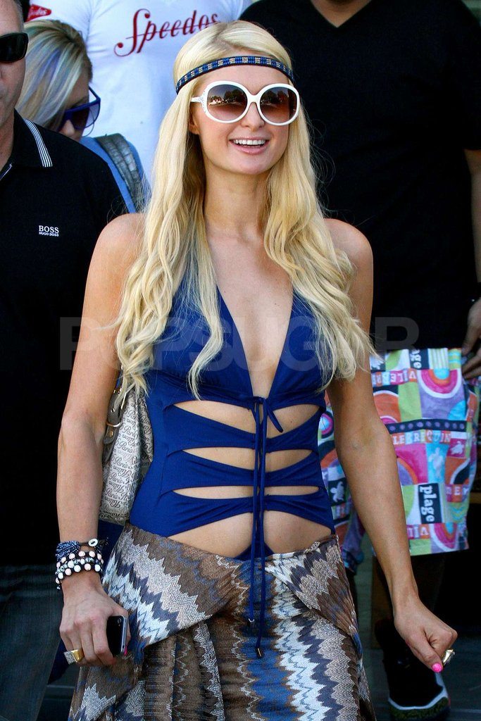 Paris Hilton looked happy to be in Australia in her blue cut-out bathing suit.