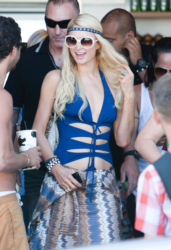 Paris Hilton partied on the beach in Australia in a blue bathing suit.