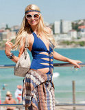 Paris Hilton wore her cover-up at her waist with a blue bathing suit at Bondi Beach in Australia.