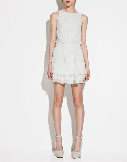 This sweet, lacy dress would be right at home at a daytime soiree. Zara Dress With Frilled Skirt ($50)