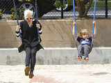 Gwen Stefani on the swings with Kingston on an LA playground.
