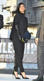 Rihanna wore all black with newly dark hair at a Battleship photocall in Japan.