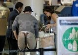 Channing Tatum and Jenna Dewan inspected their bags in the security line at the airport in LA.