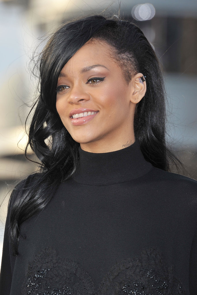 Rihanna dawned new dark hair at a Battleship photocall in Japan.