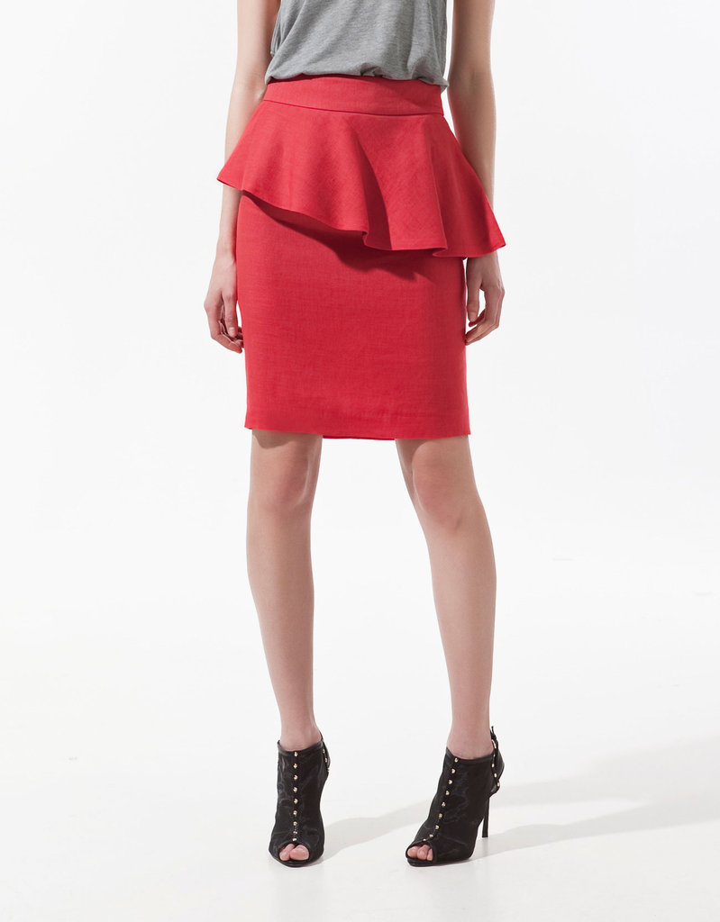 """""""I've become a little obsessed with the idea of sprucing up my office attire. This skirt is so much cooler than your average pencil, and I love the flash of bright red and alluring peplum. I'm planning to add a simple black tank and a pair of lace-up heels to channel a more effortless take on the ladylike trend."""" — Hannah Weil, assistant editor  Zara Pencil Skirt With Frill ($80)"""