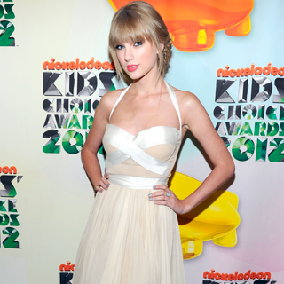 Taylor Swift Does Double Duty White: J.Mendel for the Academy of Country Music Awards and the Kids' Choice Awards: Scope It!