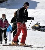 Prince William wore red pants and a black jacket while skiing in France.