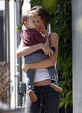 Miranda Kerr held Flynn in her yoga clothes.