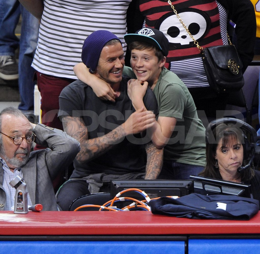 David Beckham and son Brooklyn Beckham at a Clippers game.