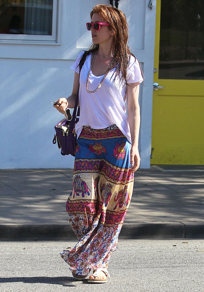 Isla Fisher wore a printed maxi skirt leaving a hair salon in LA.