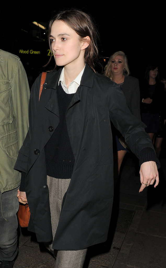 Keira Knightley wore a dark trench coat over gray slacks out in London with boyfriend James Righton.