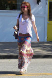 Isla Fisher wore a light pink t-shirt and a maxi skirt to a hair salon in LA.