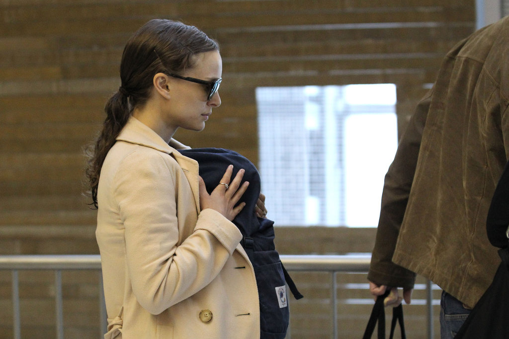 Natalie Portman went through the airport in Paris carrying baby Aleph in a carrier.