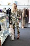 Rachel Zoe wore a patterned jumpsuit shopping in West Hollywood with son Skyler.