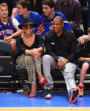 Jay-Z and Beyoncé Knowles smiled.