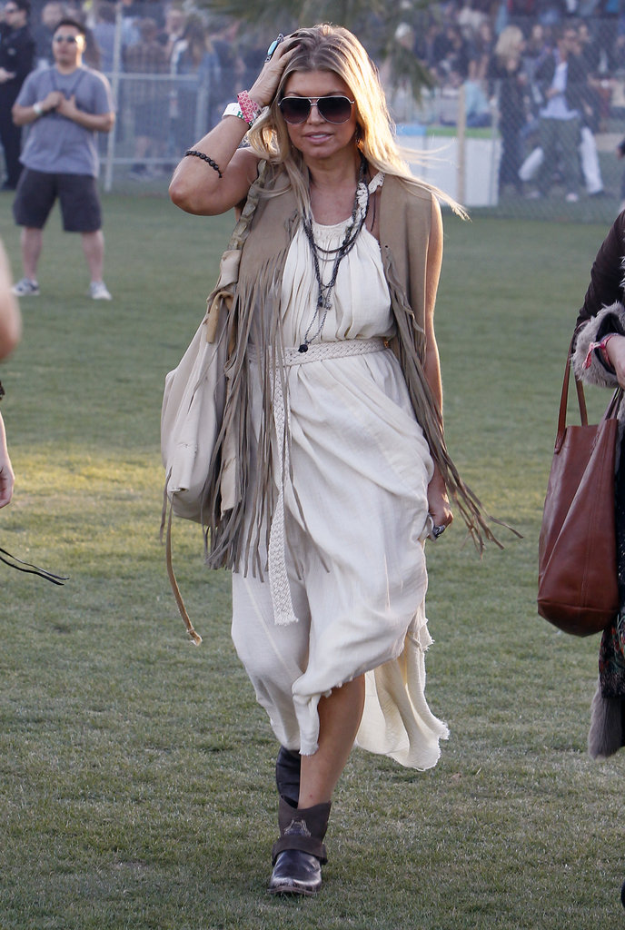Fergie was decked out in a breezy maxi dress, fringe vest, and sunhat.