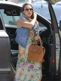 Jessica Alba hopped out of the front seat with a brown bag in hand.