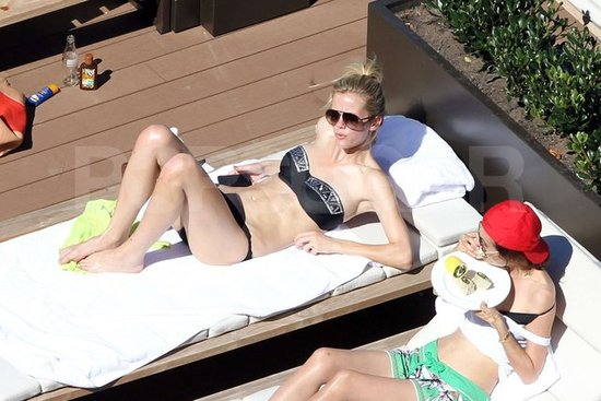 Brooklyn Decker wore a black studded bandeau bikini by the pool in Australia.