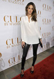 Alessandra in leather leggings and a white silky blouse — classic with an edge.