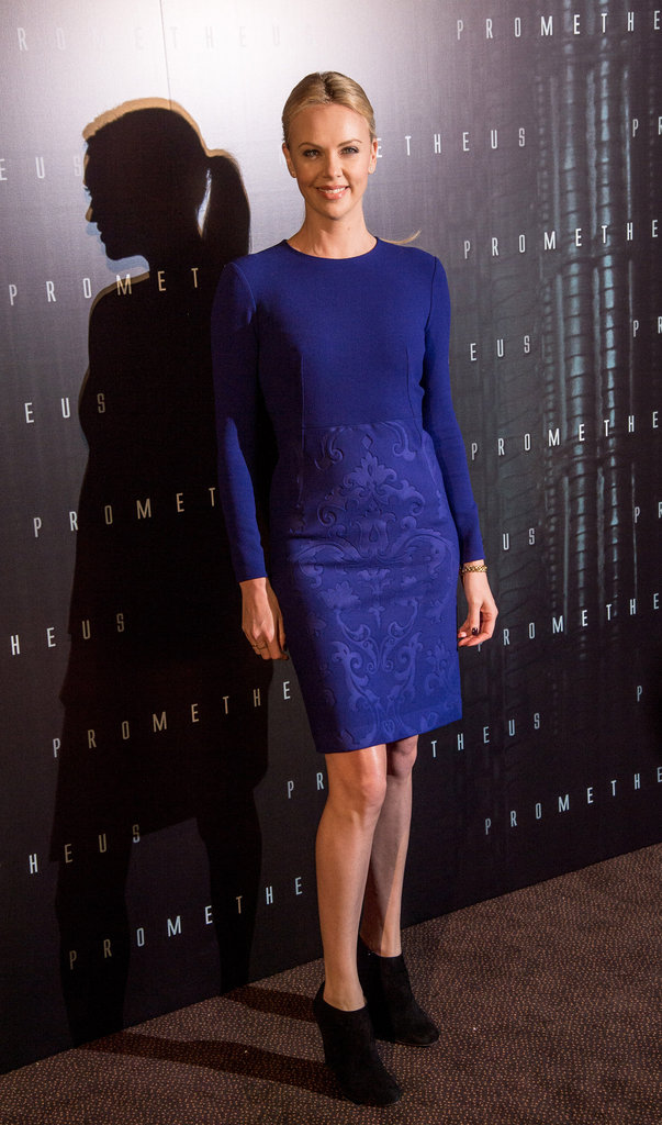 Charlize Theron wore a blue dress with black booties to the Prometheus premiere in Paris.