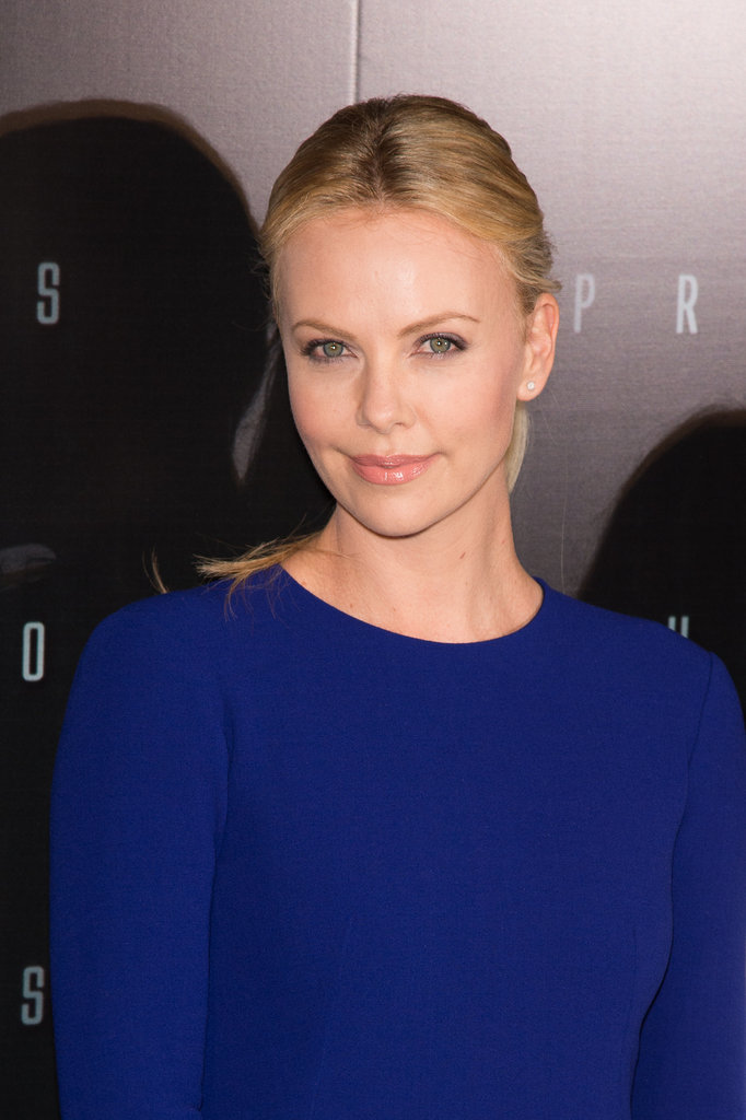 Charlize Theron wore a royal blue dress to the Paris Prometheus premiere.