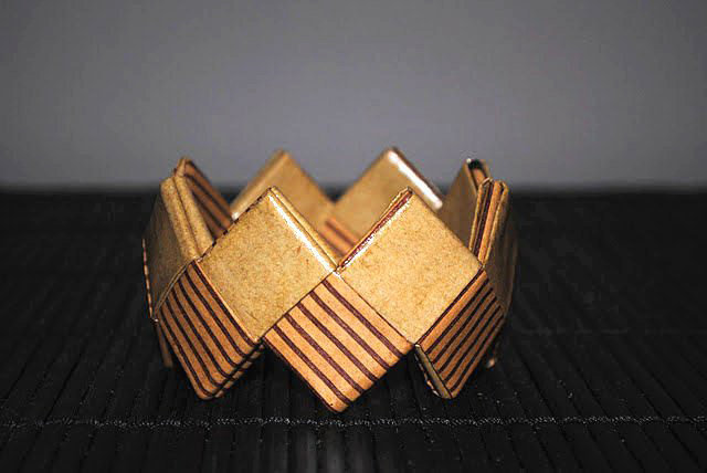 Made from recycled origami paper, this geo-shaped bangle will add structured dimension to your wrist candy. For more origami goodies, visit Flavia Mastrogiacomo's store Fraaua. Paper Origami Bangle ($17)