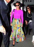 Beyoncé's black topper furthered the vintage-inspired fun of her round sunglasses and vibrant-print skirt.  4996237