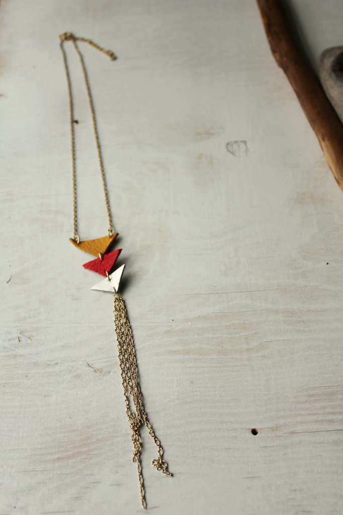 We love the bohemian look of these geometric and fringe-infused necklaces — all the more so because each is made from leather offcuts and upcycled brass chains. Leather Triangles Necklace and Chain Tassel ($18)