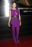 Doutzen Kroes opted for a chic purple pantsuit from Rachel Roy.