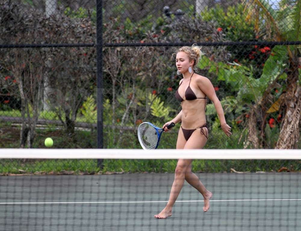 Hayden Panettiere showed off her tennis skills in a black bikini with boyfriend, New York Jets wide receiver, Scotty McKnight, in Hawaii.