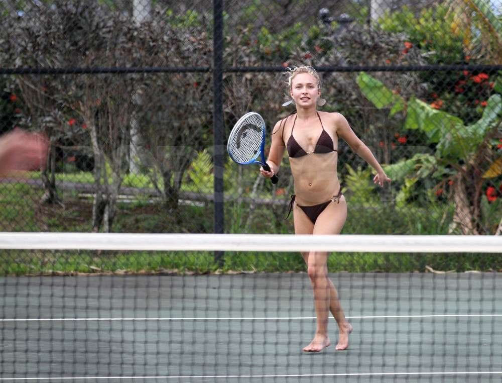 Hayden Panettiere ran after a tennis ball from boyfriend, New York Jets wide receiver, Scotty McKnight, wearing a bikini while vacationing in Hawaii.