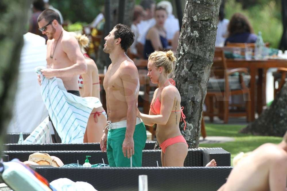 Hayden Panettiere applied sunscreen to her boyfriend, New York Jets wide receiver, Scotty McKnight, in a bikini while vacationing in Hawaii.