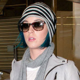 Katy Perry makes a play for pattern in printed Ray-Bans and a striped beanie.