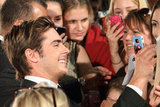 Zac Efron snapped photos with fans.