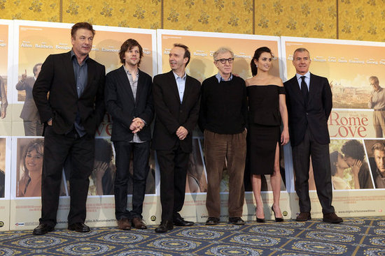 Penelope Cruz, Jesse Eisenberg, Wood Allen and Roberto Begnini stood together in front of a To Rome With Love poster at a press conference.