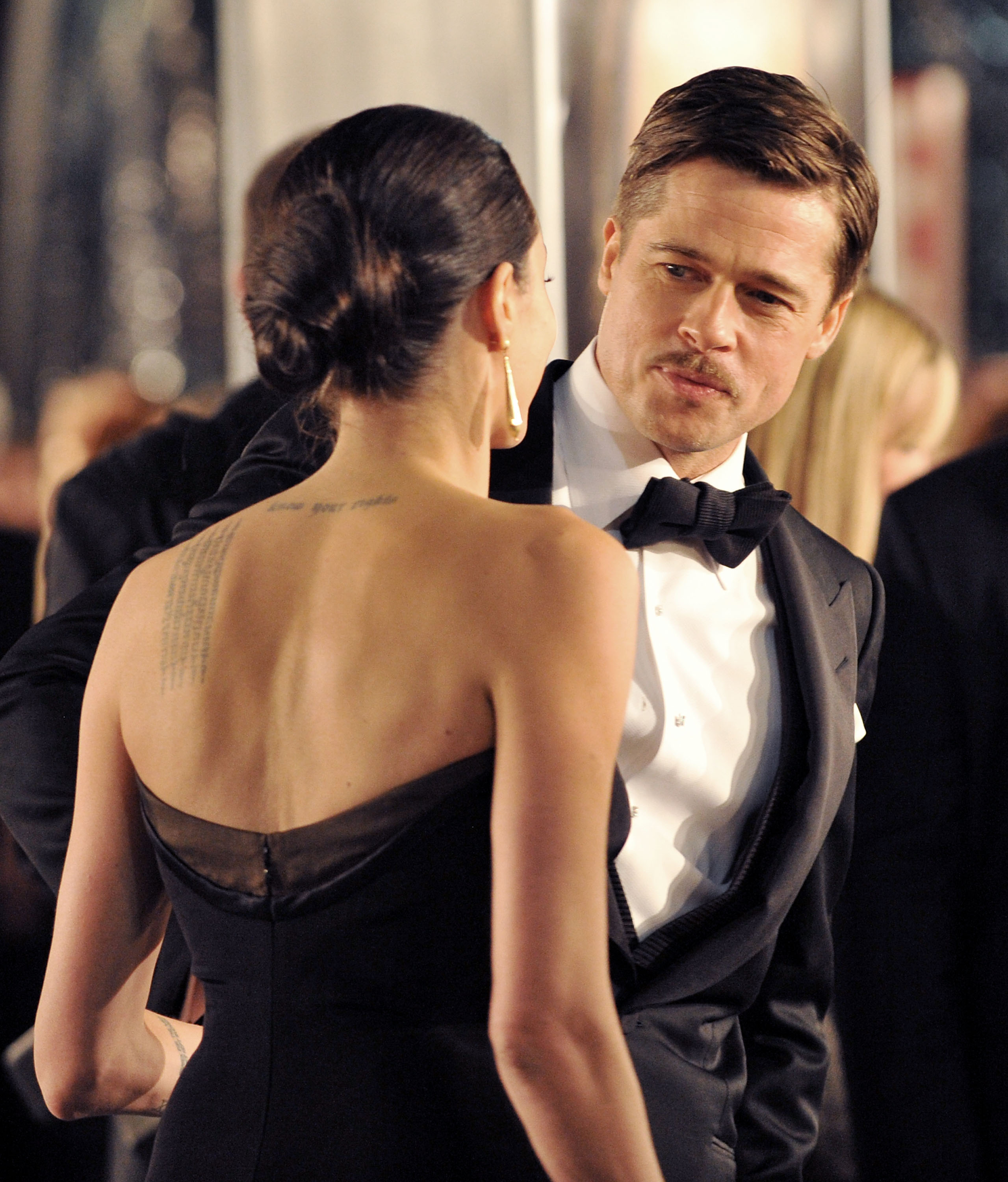 Brad Pitt stole a glimpse of Angelina Jolie at his December 2008 premiere of The Curious Case of Benjamin Button.