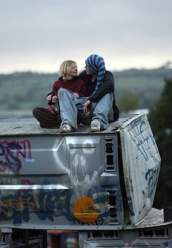 This couple chatted together on top of the Banksy installation during Glastonbury in Somerset, England.