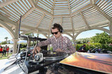 Elijah Wood showed off his musical skills at Lacoste Live!'s pool party Saturday.