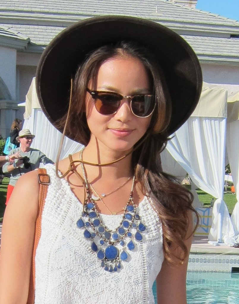 Jamie Chung pairs a cowboy hat with a pretty bohemian necklace.