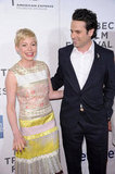 Michelle Williams smiled big as she posed with Luke Kirby.