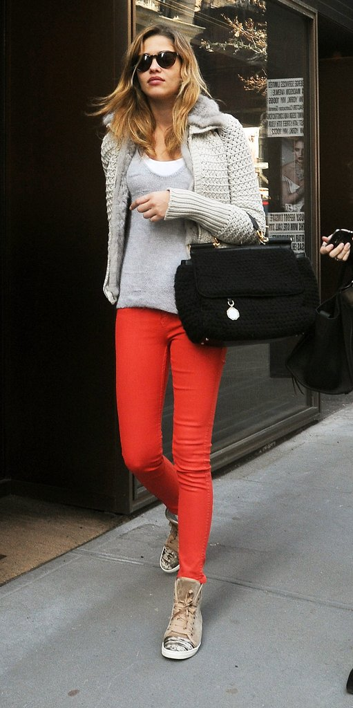 Model Ana Beatriz Barros wore a pair of snazzy Lanvin sneakers with red jeans.