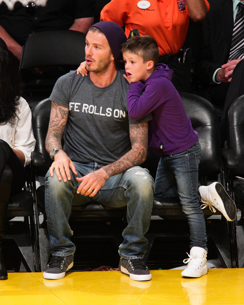 Cruz Beckham held onto dad David Beckham during a suspenseful part of the Lakers game in LA.