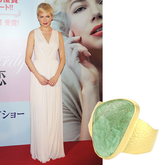 Michelle Williams wore a minimalist-chic Alexander McQueen dress to the Tokyo premiere of My Week With Marilyn and although we're a fan of this Marilyn-esque look, a strong accessory accent would really polish off this look. A gemstone gold cuff or a multicolor bracelet will provide the perfect amount of wrist candy vibrancy.