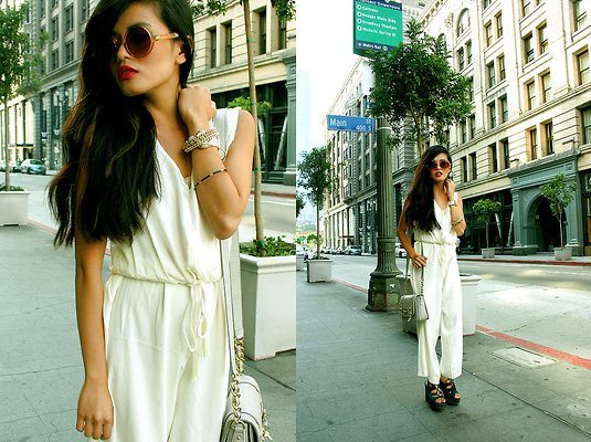 A white jumpsuit feels instantly chic — just add oversize shades and platforms to channel a touch of the disco era, without going overboard.  Photo courtesy of Lookbook.nu